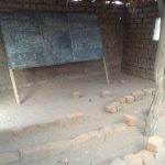 Two year groups share this classroom at Dobogo. The pupils use stones as seats.