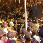 Crowded into straw classrooms