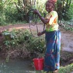 Families collect drinking water from this forest waterhole