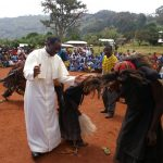 The local priest dancing with juju at CS Ndzevru